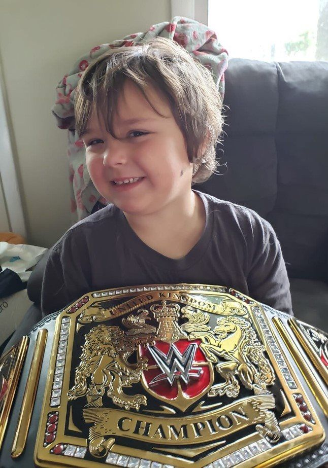 Porch pirates return WWE belt to child awaiting brain surgery and write apology letter: 'We never wanted to steal a child's hope'